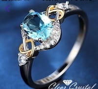 silver and blue gemstone ring New York, 10305