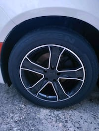 Set of four black inch rims with tires