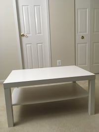white wooden single pedestal desk