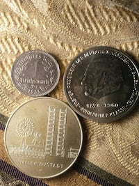 three round silver-colored coins