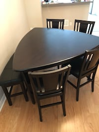 Counter-height table and 4 chairs- bonded leather and gently used!