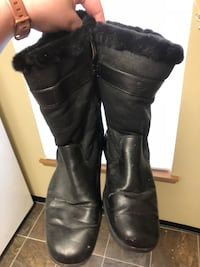 Pair of black leather fur-line high-top boots