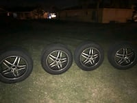 four gray 5-spoke vehicle wheels and tires 827 mi