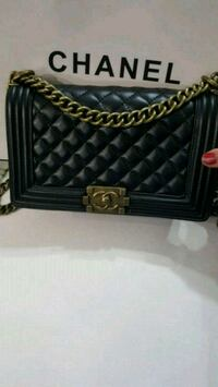 quilted black Chanel leather crossbody bag 542 km