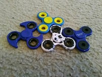 four assorted color fidget spinners 12 km