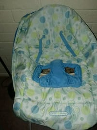 baby's white and blue bouncer