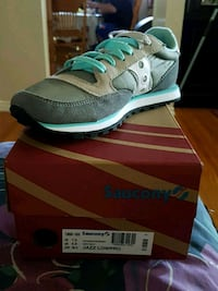 unpaired gray and blue Nike low top sneaker on box Mississauga, L4X 1N1