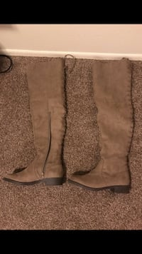 pair of brown suede knee-high boots