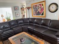 black leather sectional sofa with rectangular brown wooden coffee table
