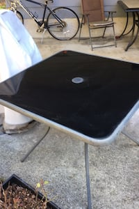 Glass top outdoor table