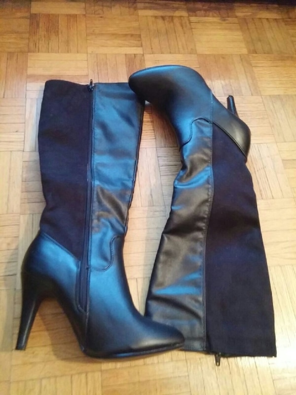 pair of black leather heeled knee-high boots