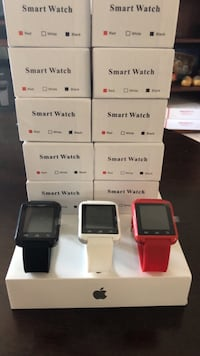 three assorted color smart watch with box