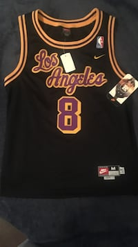 black, yellow, and red Nike Los Angeles Lakers 8 basketball jersey