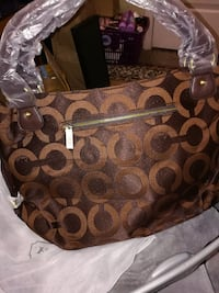 brown monogrammed Coach leather handbag