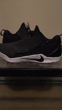 pair of black Nike running shoes Lincoln, 68507