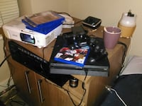 Ps4 Slim 2 controllers and games Vancouver, V5Y 3J6