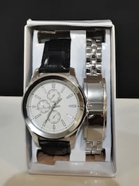 round silver chronograph watch with bro
