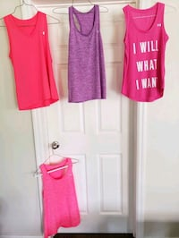 4 ladies Under armour tanks. size small