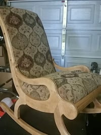 brown and white floral fabric padded armchair