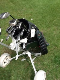 Black and white golf bag with golf clubs Men's left handed.  (16)