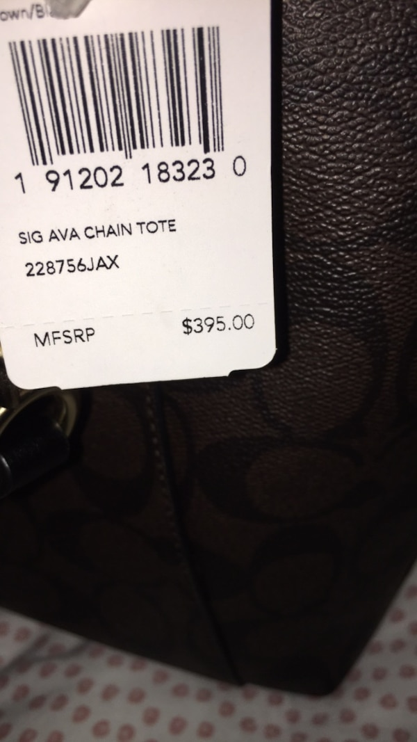 Brand new coach shoulder purse  price tag is still attached