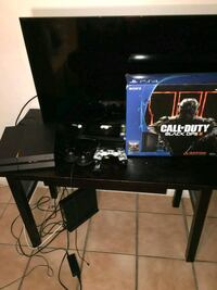 SONY PS4  with controllers and flat screen tel Lake Worth, 33467