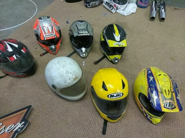 multicolored full-face motorcycle helmets