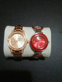 two round gold-colored and red analog watches with link straps Edmonton, T5T