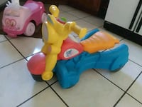yellow, blue, and red plastic motorcycle ride-on toy