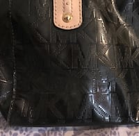 women's black Michael Kors leather tote bag