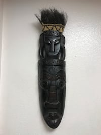 black wooden tribal wall decor