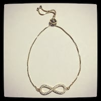 silver-colored infinity pendant necklace