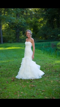 Wedding dress. Worn 1 time. Has a Shaw and a flower shoulder attachment. Is preserved in a box. Claymont, 19703