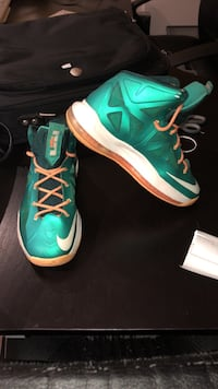 Pair of green nike basketball shoes Laval, H7R 6G2