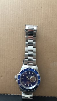 round blue analog watch with silver link bracelet