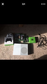 Black xbox one console with controller and game cases 25 km