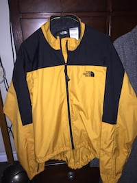 Black and yellow the north face zip-up windbreaker jacket