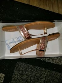 Brand new in box Guess rose gold/pink sandals. Size 9.