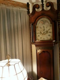 brown wooden grandfather's clock 62 mi