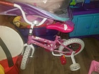 toddler's pink and white bicycle with training wheels Baltimore, 21215