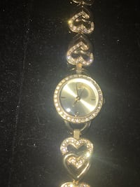 round gold analog watch with gold link bracelet Orillia, L3V 0T7