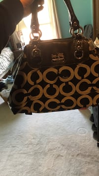 Black and brown coach hand bag