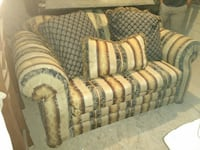 black and brown fabric stripe loveseat