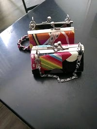 two womens multicolored leather clutch bags