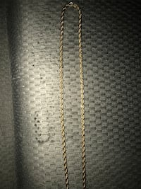 gold-colored twisted chain necklace