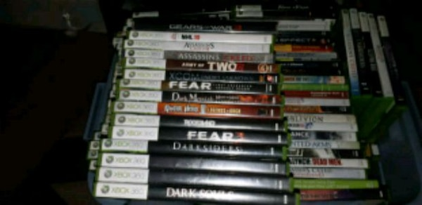 assorted Xbox 360 game cases 30d5184b-e233-4037-903b-c3f8fae80a4b
