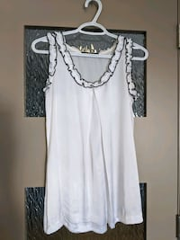White sheer blouse with black trim around the neck size small
