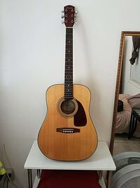 brown and black Fender dreadnought acoustic guitar