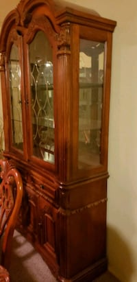 brown wooden framed glass display cabinet Rio Rancho, 87144