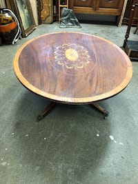 """Oval inlaid coffee table 17 1/2 inches tall, 45"""" long, 36"""" deep Toronto, M2R 3N1"""